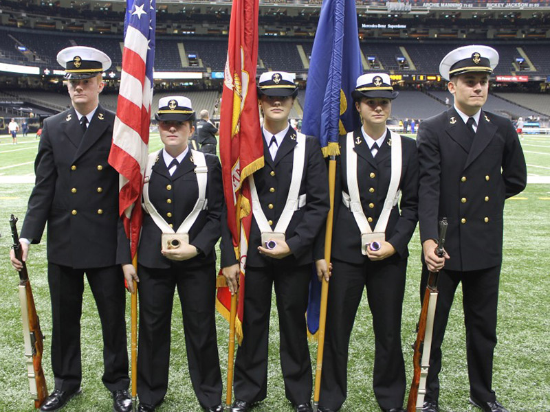 The Tulane NROTC stands with their flags at the Superdome